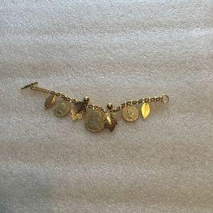 Lovely gold tone Queen Elizabeth II coin bracelet